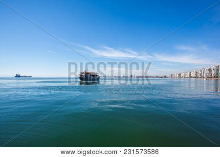 Cruise Ship For Sightseeing On Promenade Along Shore Of Aegean Sea In Thessaloniki, Greece