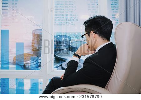 Young Handsome Businessman With Eyeglasses Sitting On Sofa Chair In Modern Office And Double Exposur
