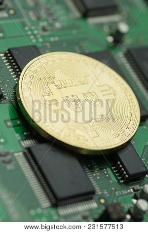 Close-up Of Golden Bitcoin On Green Printed Circuit Board With Microchips