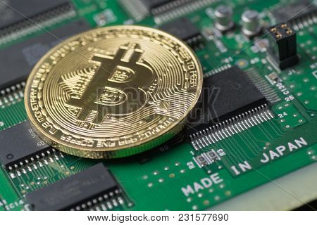 Golden Bitcoin On Printed Circuit Board With Microchips Made In Japan