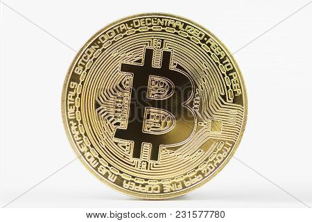 Close-up Of Golden Bitcoin On White Background