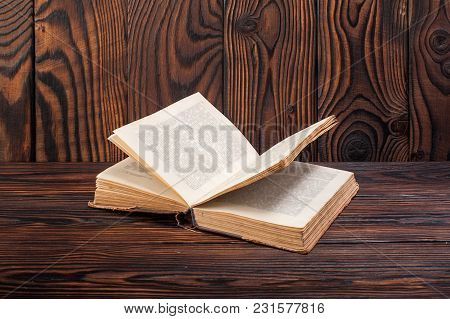 Old Books On A Wooden Background With Copy Space To The Right