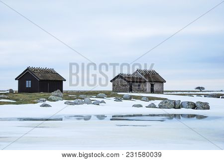 Historical Fishermens Cabins In An Open Winter Landscape At The Swedish Island Oland In The Baltic S