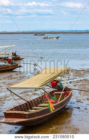Wooden Long Tail Boats On Mud Flats In The Maeklong River In Thailand