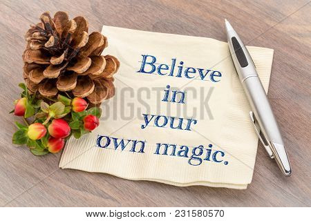 Believe in your magic - handwriting on napkin with a pine cone