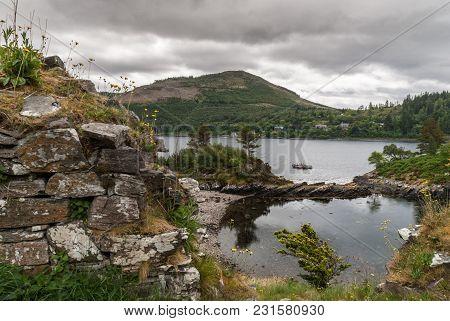 Stromeferry, Scotland - June 10, 2012: Wide Shot, Pool In Rocks At Base Of Castle Strome Ruins On Gr
