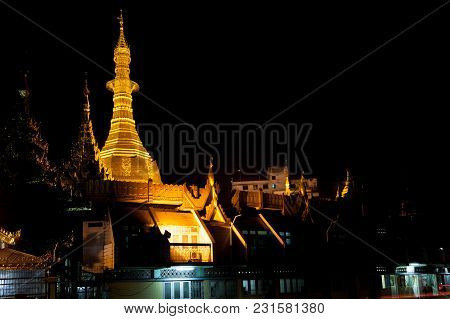 The Illuminated Golden Stupa Of The Sule Pagoda In Downtown Yangon At Night, Myanmar