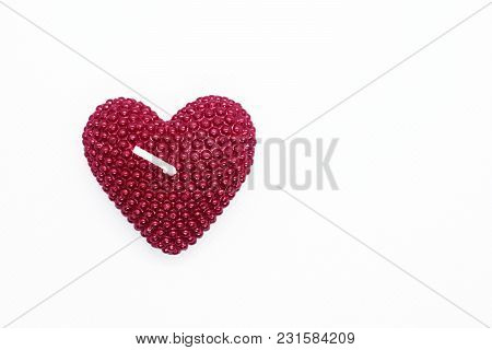 Red Heart Shape Unburned Candle On White Background With Copy Space For Text For Greeting Card.