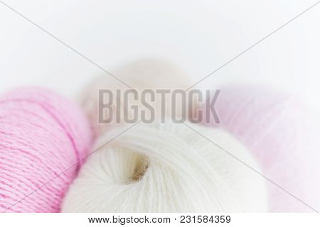Balls Of Colorful Fluffy Yarn On White Background Close-up