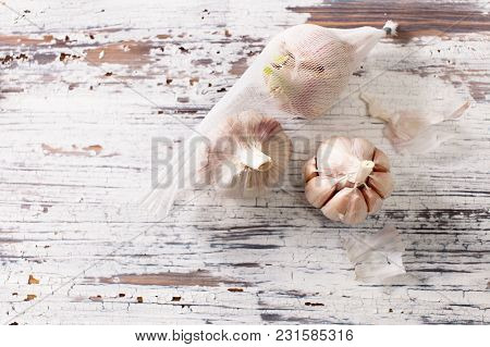 Garlic On An Old Wooden Table. The View From The Top.