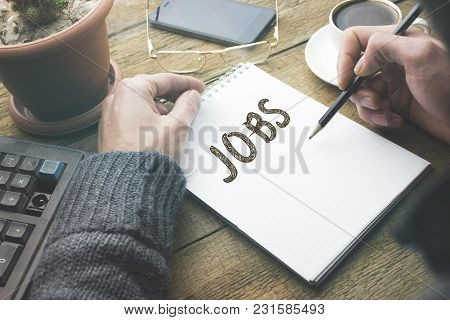 Man Hand Pen And  Job Word On Notepad