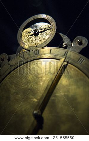 The Ancient Clocks Made With Copper On Dark Background
