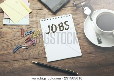 Job Word On Notepad On Working Table
