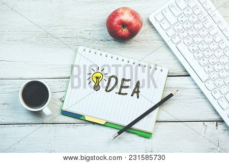 Idea Write On Notepad And Keyboard And Coffee On Table