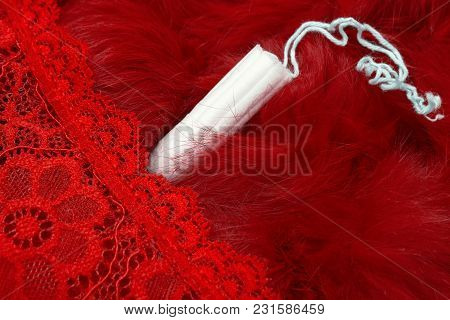 Red Fur, Red Pants And A Menstrual Tampon. Vaginal Products For Intimate Care. Woman Critical Days,