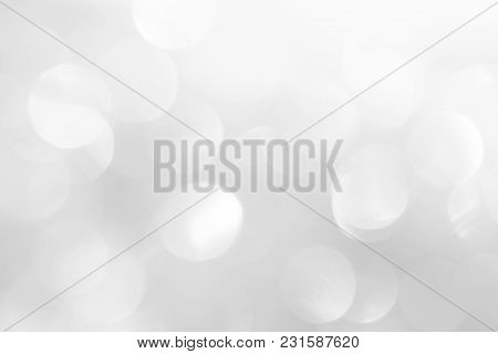 A brilliant blurry white background for a festive mood. Template for greeting card for entertainment