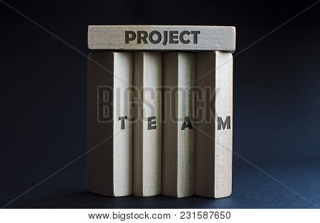 Four Wood Blocks As A Team Holding One Horizontal Wood Block Above Them As A Project. Concept Of Bus