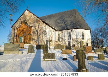 Medieval Lutheran Church In The City Cemetery On A Sunny February Day. Halikko, Finland