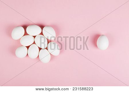 White Eggs On Pink Background. Top View