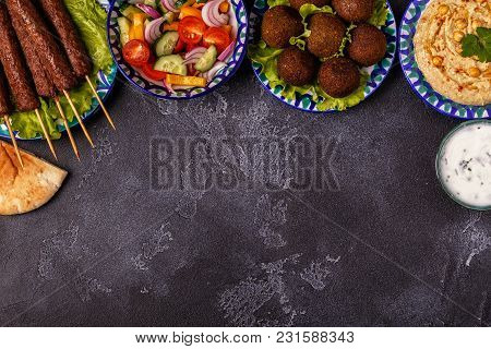 Classic Kebabs, Falafel And Hummus On The Plates. Top View, Copy Space.