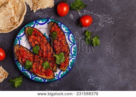 Baked Eggplant With Tomatoes, Onion, Garlic And Parsley. Top View
