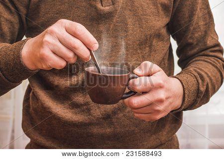 Man Prepares Coffee,  Useful Drink During  Break In Work