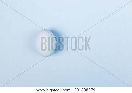 Blue Egg On Blue Background. Top View, Copy Space. Food Background