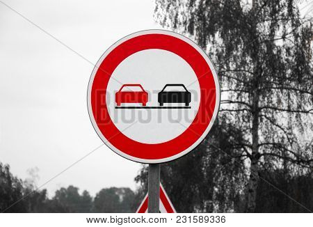 European (slovakia) Prohibited Overtaking Sign On The Road With Other Sign Behind On Black And White