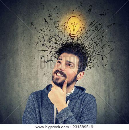 Young Happy Man Has A Bright Idea