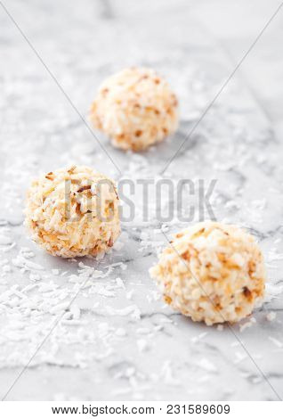 Assortment Of Luxury White Chocolate Candies Variety On White Marble Background