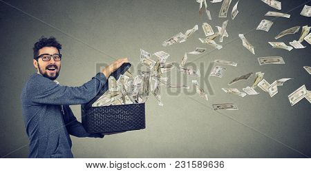 Excited Business Man Opening A Box Letting Dollar Banknotes To Fly Away