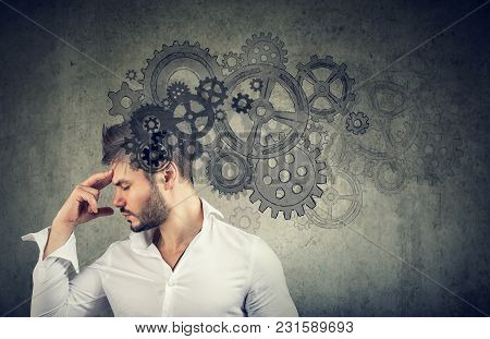 Serious Young Man Thinking Very Hard Solving A Problem
