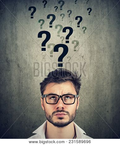 Perplexed Man With Too Many Questions And No Answer