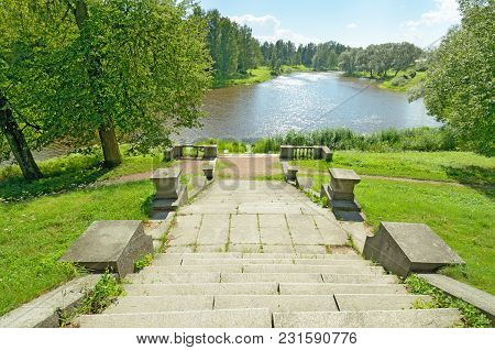 Stone Staircase On A Hill In The Park.around Nature With Green Vegetation.