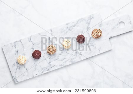 Assortment Of Luxury White And Dark Chocolate Candies Variety On White Marble Background>top View
