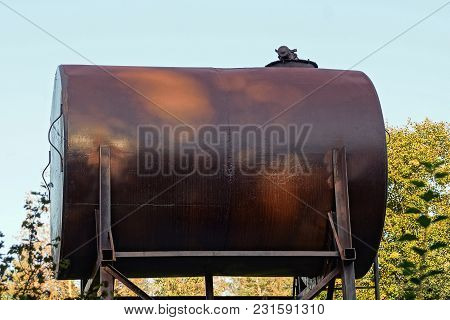 Large Brown Old Tank Against The Sky