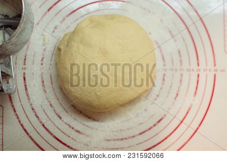 Close-up View Of The Homemade Raw White Dough Ball Lying On The Cooking Surface. Dough For Pizza, Pa