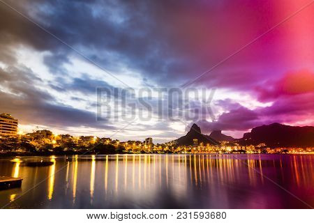Lakeside View Of Lake During Sunset, Almost Dark. Rodrigo De Freitas Lagoon, Rio De Janeiro, Brazil