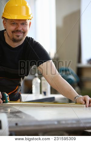 Handsome Worker Measuring. Manual Job Diy Inspiration Improvement Job Fix Shop Yellow Helmet Joinery