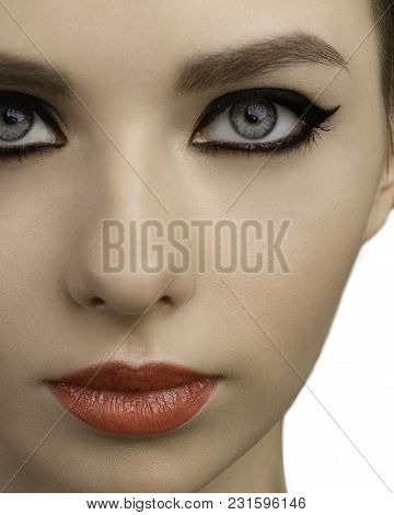 Beautiful Face Of Model Of The Woman With Bright Cosmetics Of A Charm. Pure Skin, Black Eye Shadow A