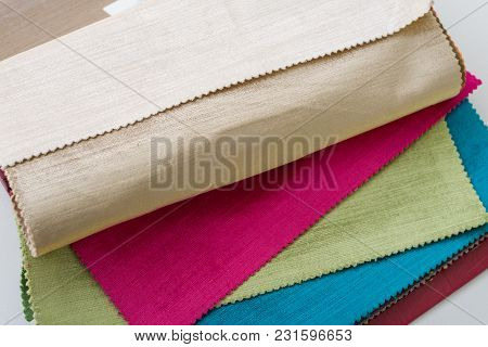 Samples Of Colorful Interior Fabrics. Book Of Fabrics For Curtains, Upholstery.