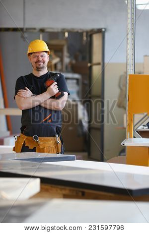 Arms Of Worker Using Electric Drill Closeup. Manual Job Diy Inspiration Improvement Fix Shop Yellow