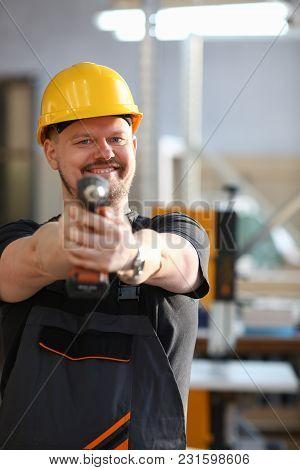 Arms Of Worker Using Electric Drill Closeup. Manual Job Diy Inspiration Improvement Fix Shop Yellow