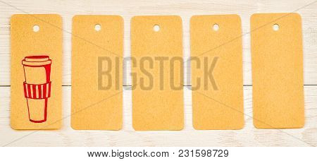 Set Of Recycled Paper Tags With Cute Pink Drawing Of Coffee Cup On White Wooden Background