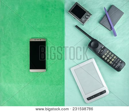 A Smartphone And The Things That It Replaced, On Different Halves Of A Two-colored Rectangle. Pale G