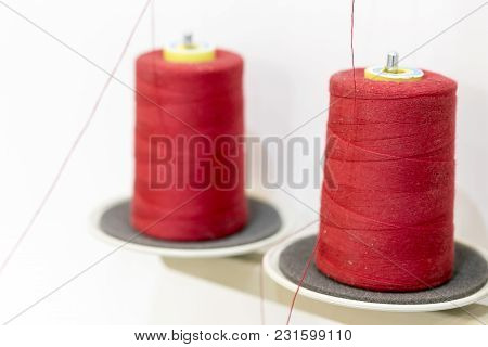Two Red Thread Coils. Threads For Industrial Sewing Machines.