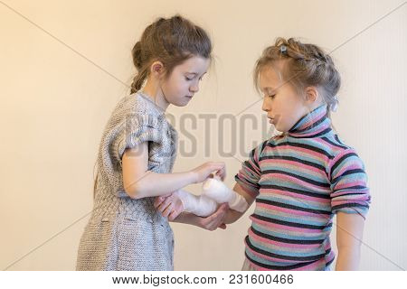 Two, Girls, Play, Doctor. Bandage Your Arm With A Bandage. Hand Injury. First Aid.