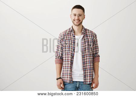 Portrait Of Attractive Caucasian Guy In Transparent Glasses, Smiling Broadly Wearing Fashionable Clo