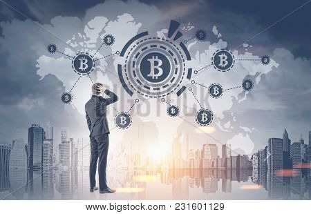 Rear View Of A Confused Businessman Scratching His Head And Thinking. An Isolated Portrait. Bitcoin