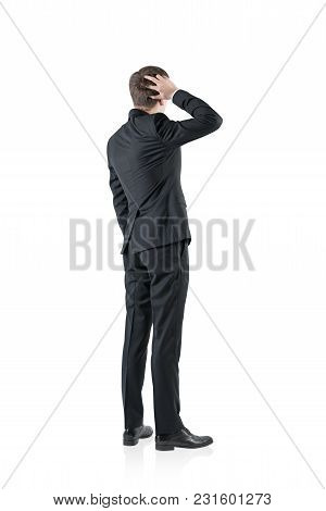 Rear View Of A Confused Businessman Scratching His Head And Thinking. An Isolated Portrait. Concept